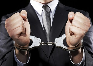 Businessman hand cuffed (mid section)