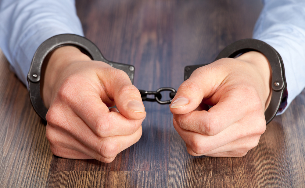 Handcuffed Arrested on Assault Charges