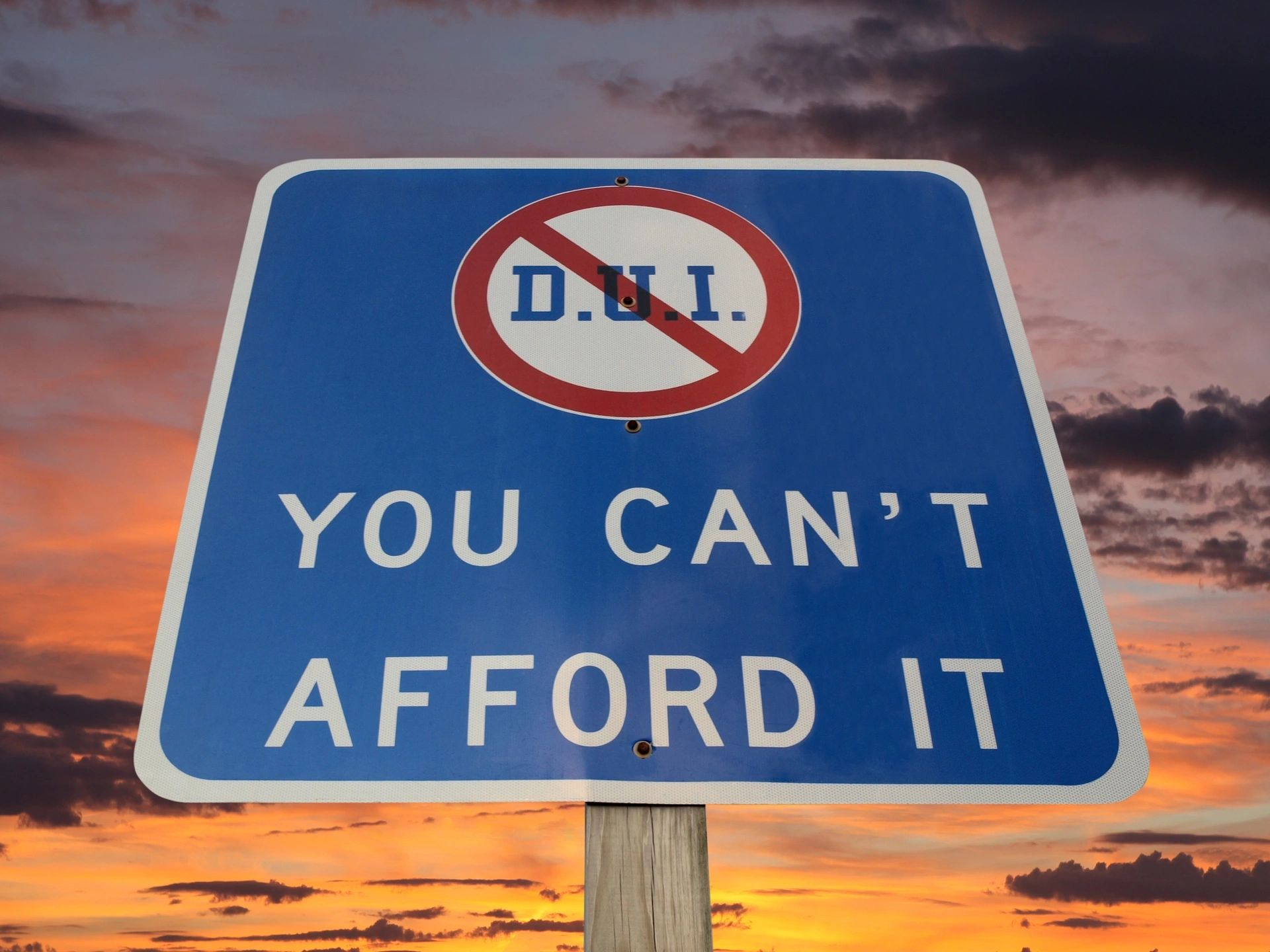 Sign that says DUI DWI will cost you