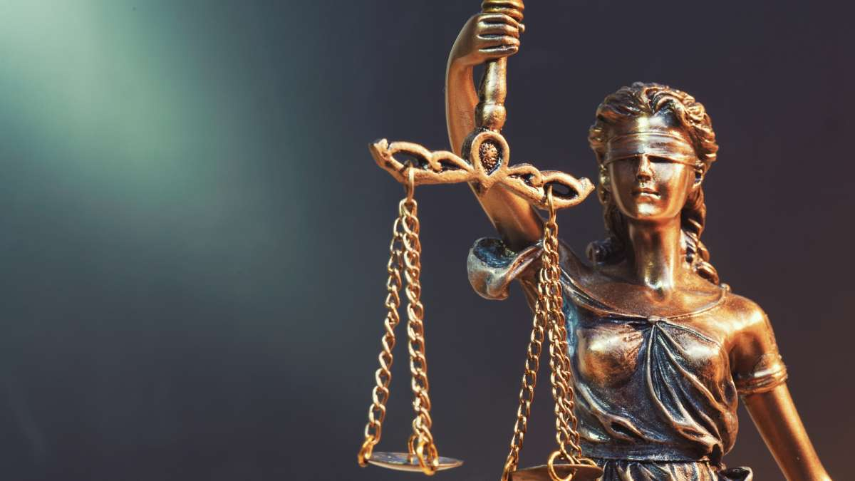 Lady Justice Statue Weighing Guilt vs Innocence