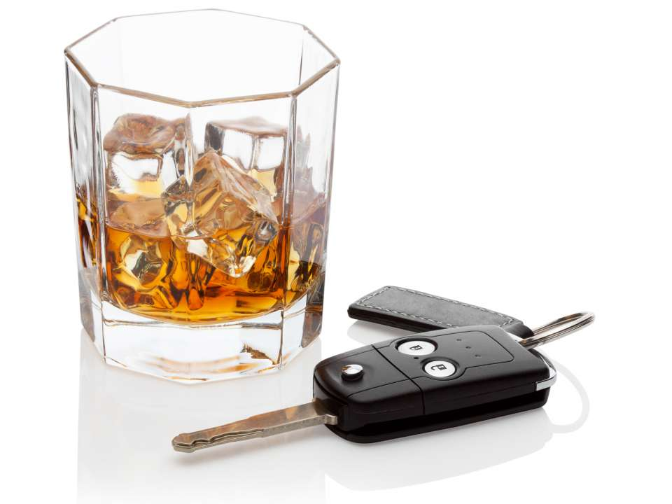 Glass of whiskey and car keys DUI DWI Drunk Driving